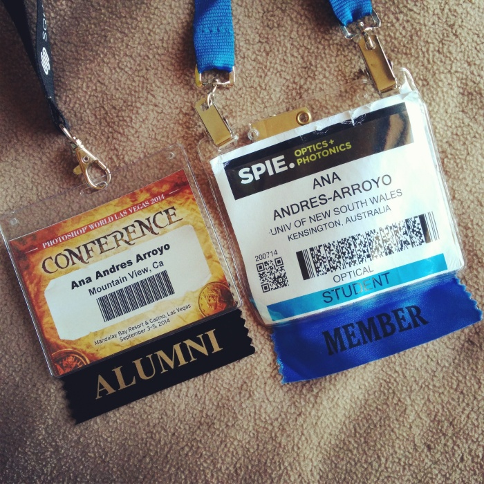 Conference badges for Photoshop World on left and SPIE Optics and Photonics on right.