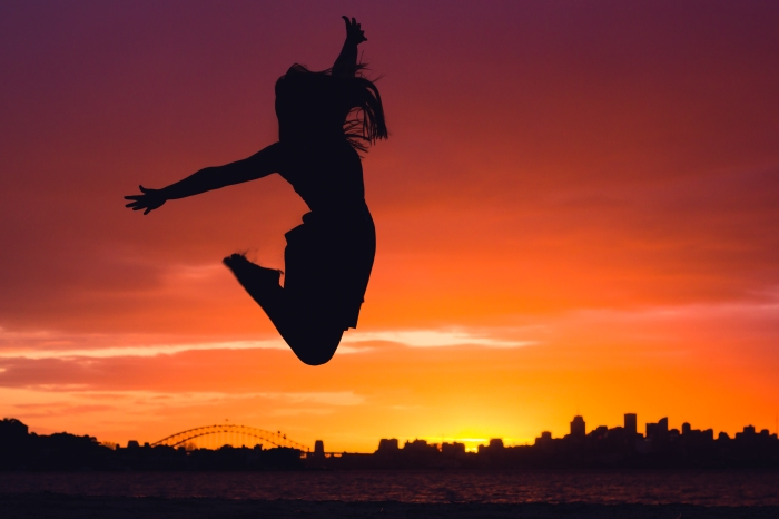 Nic Douglass from Adventures of a Sailor Girl jumps over Sydney at sunset!